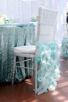 aqua colored sequin tablecloth and ruffled aqua chair covers