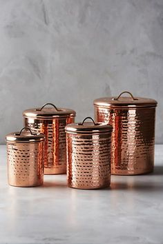 Copper-plated Canister Set Of by Anthropologie Shop this product on Havenly, where you can also browse similar products across other brands and even get interior design help to transform your space. Rose Gold Kitchen, Interior Design Help, Copper Rose, Copper Color, Canister Sets, Flour Canister, Kitchen Essentials, Organizer, Home Decor Accessories