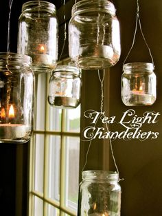 """upcycled baby food jar chandelier- fun to do and add """"mercury"""" painted on bottom so they sparkle Baby Jars, Baby Food Jars, Cute Crafts, Creative Crafts, Diy Crafts, Decor Crafts, Mason Jar Wine, Mason Jar Lamp, Baby Food Jar Crafts"""