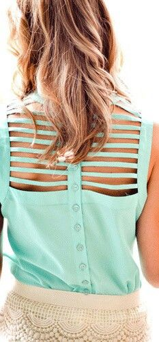 This a mint buttoned shirt with a cutout back.