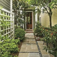 Modern stone walkway paired with earthy house palette
