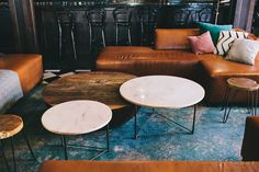 Custom sofas and tables in the new Finca in downtown Salt Lake City. Design by cityhomeCOLLECTIVE. #pink #marble #leather #teal #custom