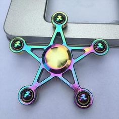 Rainbow Sheriff Star Fidget Spinner Metal EDC Hand Toy. BUY NOW: https://www.fromouttathisworld.com/products/rainbow-sheriff-star-fidget-spinner-metal-edc-hand-toy