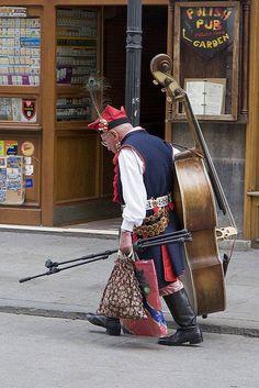 278 krakow 07 05 27    Main market square (Rynek Glowny), Krakow. Street musician in traditional dress