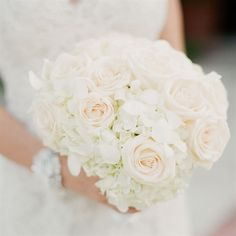 white and ivory roses with white hydrangeas and baby orchid blooms. (Note: maybe use a brigther pink)