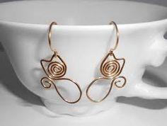Risultati immagini per cat earrings