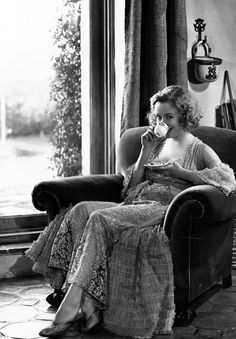 Miriam Hopkins looking lady like sipping tea.