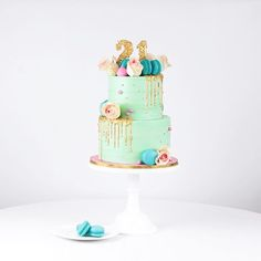 WEBSTA @ junipercakery - Super fun gold sequin drip birthday cake adorned with bright turquoise Madagascan vanilla macarons, pink meringue kisses and pale pink roses!