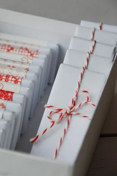 Candy cane string and white paper, such a simple and stunning gift wrapping combo!