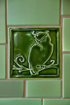 A detail of the owl decorative tile in an Evergreen gloss glaze, by Carreaux du Nord.