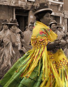 Cholita, traditional women in La Paz Bolivia, dancing morenada
