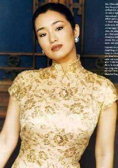 Gong Li wearing the timeless Qipao in an elegant fashion