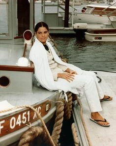 Ali McGraw in white jeans and a white coat in 1970.