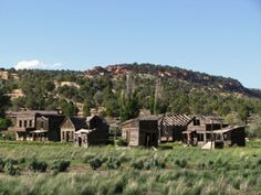 """Ghost towns in Utah are an integral part of the state's history. And no matter where you go in the state, you're likely to come across a """"ghost town"""". Utah Vacation, Vacation Places, Vacation Trips, Old Abandoned Buildings, Abandoned Places, Ghost Towns Of America, Haunted Places, Haunted Towns, Old West Town"""