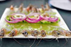 Flash marinated in freshly squeeze lime juice (with salt and finely diced jalapenos), these raw camarones are supple and crazy delicious. Served topped with sliced red onion and summer cucumber.