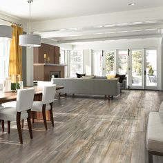 For a rustic look, install pine handscraped wood plank laminate flooring from Pergo. Click this pin to get started with your flooring project today!