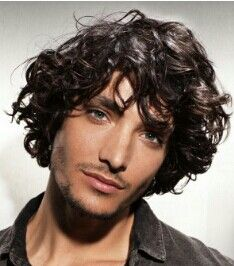 Long style for men with waves or curls in their hair.