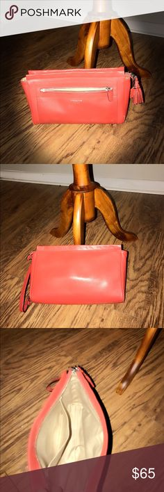 ❤️Coach wristlet❤️ This is a used Coach large wristlet.  I used it for a while and although clean, you can expect to find a little dirt on the bottom.  It is an awesome orange color and has tons of life left in it!! Coach Bags Clutches & Wristlets