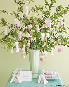 """Favor Tree    Ready to be plucked from the branches of a quince """"tree,"""" dragees grouped in glassine bags are a delectable snack. Keep branches in water; arrange additional favors alongside."""