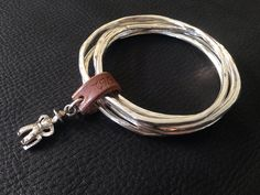 silver and leather bangles by 962