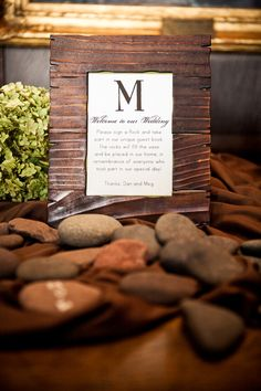 Have guests sign stones, which will be put in a vase. | PrimaveraStudios.com