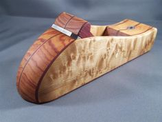 Wooden Plane. I don't care whether the bottom is flat or not. It's beautiful.