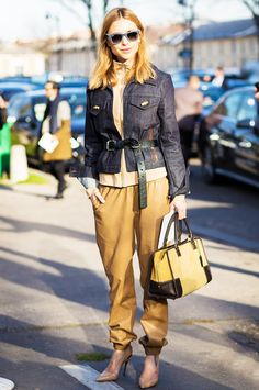 Pernille Teisbaek in an Acne Studios jacket and belt + Ganni zip-up sweater + Day Birger et Mikkelsen leather joggers + Celine pumps and a Loewe Amazona tote