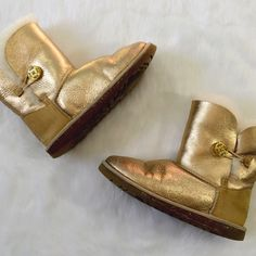 UGG Bailey Button Metallic Gold Boots Show some wear but still PLENTY of shine on these super comfy UGG boots! UGG Shoes Winter & Rain Boots