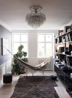 Home decor idea: hang a hammock up in your living room to relax by the window and read books. So cute.