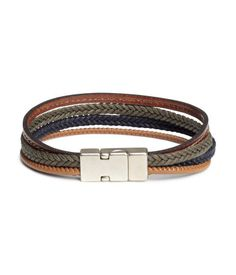 Bracelet with imitation leather straps and a metal clasp with a magnetic fastener. Length 8 1/2 in.
