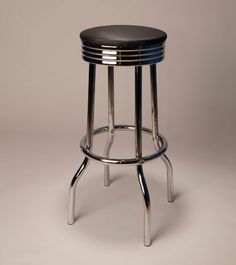 "Carbon Fiber look 30"" Barstools with Chrome Legs Swivel Black Seat Footrest (Set of 2) by Cortesi Home. $152.00. Price is for the set of 2 Barstools. Stain Resistant. Easy Assembly Required. Set of 2 barstools with Carbon Fiber look vinyl finish seat and chrome finished steel legs with footrest. Dimensions: 30"" High to the seat. 12.5"" Seat Diameter"