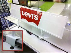 """This Levi's Sign Clamp Close-to-the-Edge setup is """"close to the edge"""" not only in position, but also in terms of danger. The thumbscrew of the C-clamp. Glass Wall Shelves, Floating Glass Shelves, Display Design, Store Design, Price Tag Design, Clothing Store Interior, Retail Fixtures, Promotional Design, Visual Merchandising"""