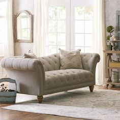 Features:  -Reinforced hardwood frame.  -Natural, linen-like upholstery.  -Sinuous springs.  -Chrome nail head trim.  -Please note, upholstery is not pre-treated with a stain Protectant.  -Material: 5