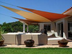 Terrasse couverte d'une voile tendue - Marie Claire Maison