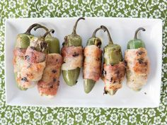Marcela's Grilled Stuffed Jalapeno Chiles : Marcela removes the seeds from the jalapenos before stuffing them with mozzarella and wrapping them in bacon. Cooking them on the grill sizzles the outside, while the inside becomes oozy and creamy. Mexican Cooking, Mexican Food Recipes, Ethnic Recipes, Chile, Grilled Stuffed Jalapenos, Stuffed Peppers, Bbq Appetizers, Appetizer Recipes, Mexican Made Easy