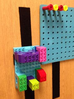 By placing these activities on a vertical surface, the child is required to coordinate his hand movements with what he sees in order to accurately place the pegs into a hole.