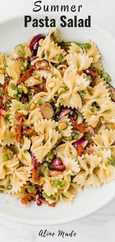 A favorite vegan Italian pasta salad with sun-dried tomatoes, roasted pine nuts, and fresh herbs – perfect for every summer party. Tomato Pasta Salad, Best Pasta Salad, Summer Pasta Salad, Pasta Salad Italian, Pasta Salad Recipes, Vegan Recipes Easy, Italian Recipes, Vegetarian Recipes, Pasta With Herbs
