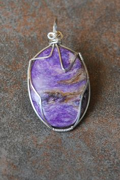 Check out this item in my Etsy shop https://www.etsy.com/listing/118960827/sterling-silver-wire-wrapped-charoite