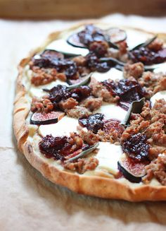 Sausage, goat chesee, carmelized onions, and fresh fig pizza.