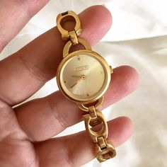 Gorgeous gold Coach watch! Beautiful, excellent condition authentic gold plated Coach watch. Vintage design, not in production anymore. This is made for a small wrist, and does not come with extra links. Can provide measurements if needed! Very minor scuffing/wear on the back of the face (none in the face itself) and in lovely condition after gentle use. Does not come with original packaging. A beautiful delicate watch. Happy to provide more photos if interested! Feel free to make an offer…