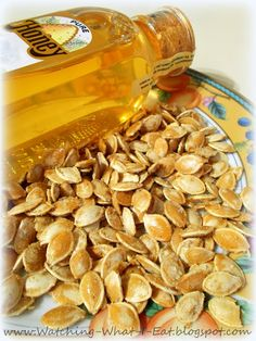 Toss some fresh pumpkin seeds with oil olive & roast in a 350 degree oven for 25 minutes, stirring occasionally. Then toss with honey & salt and roast for 5 more minutes. Upon taking out of the oven sprinkle them with a little sugar.