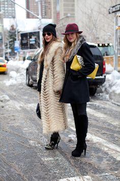 Beanie, fur, studded booties, my kinda winter gear. NYFW 2013 street style-photo cred: Diego Zuko