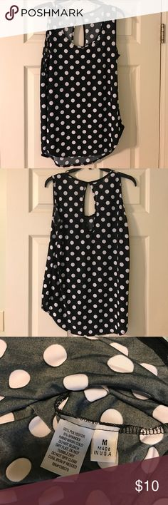 Evereve Black Tank White Dots Black top with white dots. Fun cut-out in the back (see pics) no stains or snags or fading- very good condition. Evereve Tops Tank Tops