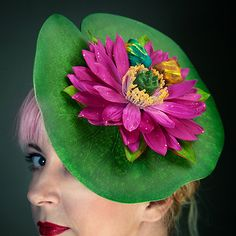 This is a large lily pad fascinator with a pretty, deep pink flower and two kissing frogs. The lily pad is set on a small black base that is shaped. Little Mermaid Costumes, The Little Mermaid, Floral Headdress, Flower Costume, Crazy Hats, Fascinator Hats, Fascinators, Pinup Couture, Glitter Hair