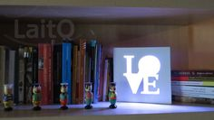 Love. 21cm x 21cm x 3cm. To support on the table or hang on the wall. Color changing LED remote controlled lamp.