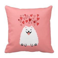A cute, happy white Pomeranian dog pillow with pink background and hearts! A super sweet Valentine's Day gift idea for dog lovers!