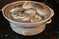 Baked potatoes in a crock pot! = The Fun Cheap or Free Queen: Baked Potato Bar...perfect party food! Plus, how to bake potatoes in the crock pot