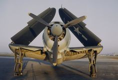 World War II Photos — History.com Picture Galleries World War 2 Helldiver Aircraft: Navy Curtiss-Wright SB2C Helldiver with wings folded up, 1944.