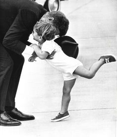 With all the exuberance of his few years, little John F. Kennedy Jr. runs into his father's arms as the President arrived for a family weekend in Massachusetts during the summer of 1963.
