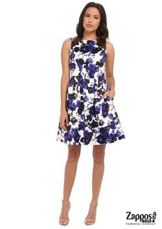 Whether you're brunching with your friends or heading to a family gathering,  you'll bloom beautifully in this floral fit-and-flare dress by Vince Camuto.